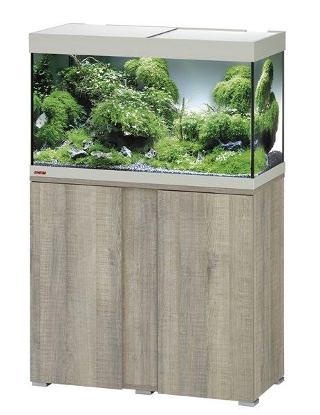 EHEIM SET VIVALINE 126 LED+ 81X36X119 CM GRIJS EIKEN De Eheim Vivaline Led+ serie kan perfect aan uw interieur worden aangepast door het feit dat het decorpaneel in het meubel verwisselbaar is. Daarmee wordt uw aquarium zo individueel als u wilt. Kleur: Grijs-Eiken, Wit, Antraciet Inhoud: ca. 126 L; Grootte aquarium: 80 x 35 x 45 cm Inclusief: 1 x 10,6 W Classic Led Day 1x Eheim Buitenfilter Experience 150 (2422); 1x Jäger verwarmer 100 W Alleen als set verkrijgbaar; Grootte set: 81 x 36 x 119 cm